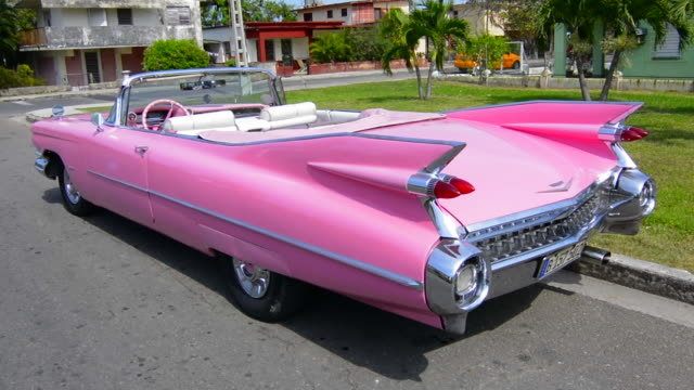 varadero beach cuba famous pink 1959 big pink cadilllac with fins and abstracts on street - varadero stock videos and b-roll footage