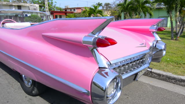 Varadero Beach Cuba famous pink 1959 big pink Cadilllac with fins and abstracts on street