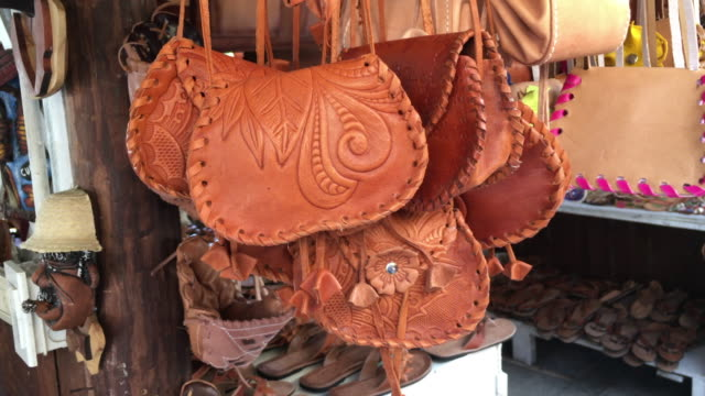varadero, cuba: handcrafted pure leather purses for sale as tourist souvenirs - varadero stock videos and b-roll footage