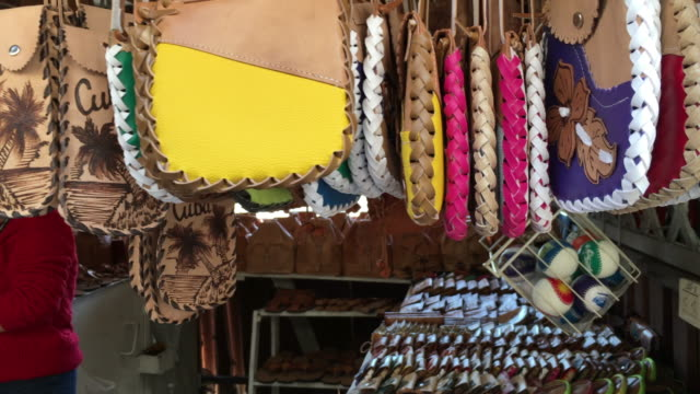 varadero, cuba: handcrafted pure leather purses for sale as tourist souvenirs - 思い出点の映像素材/bロール