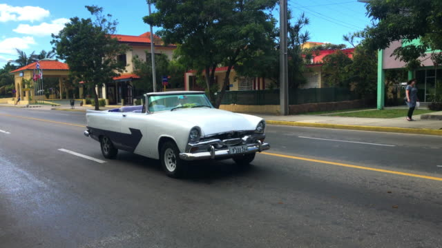 varadero, cuba: old vintage cars working as tourist taxi on the 1st avenue of the resort town - collector's car stock videos and b-roll footage