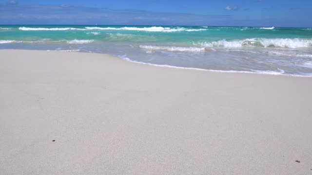 varadero, cuba, waves of transparent water crashing in the white sand - varadero stock videos and b-roll footage