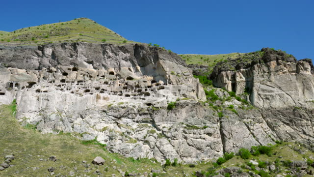 vardzia old stone city - cliff dwelling stock videos & royalty-free footage