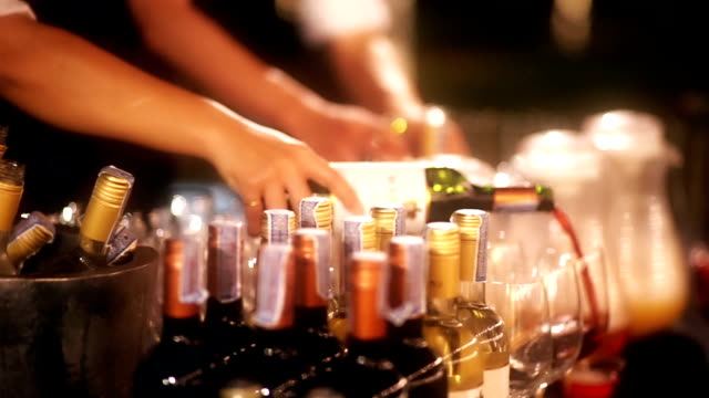 variation of alcohol drink bottle served at the bar counter in party at night. - alcohol abuse stock videos & royalty-free footage