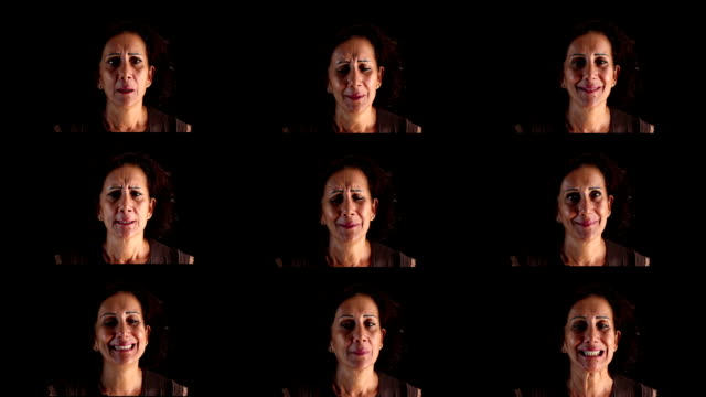 Variation of facial expressions by mature adult woman