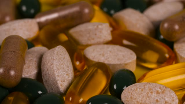 varied pills and capsules rotate - vitamin stock videos & royalty-free footage