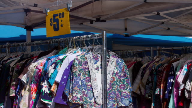MS Varieties of dresses hanging in outdoor market for sale / Los Angeles, California, United States