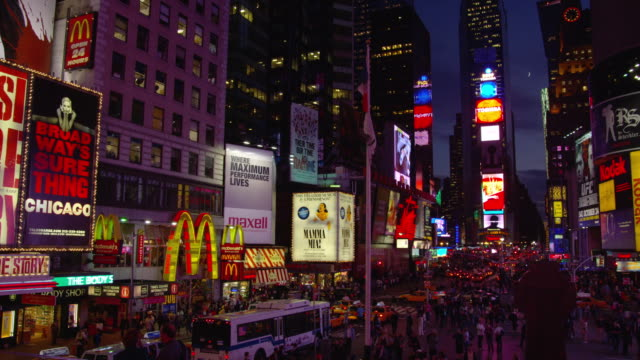 a variety of billboards flash above times square in new york city. - mcdonald's stock videos & royalty-free footage