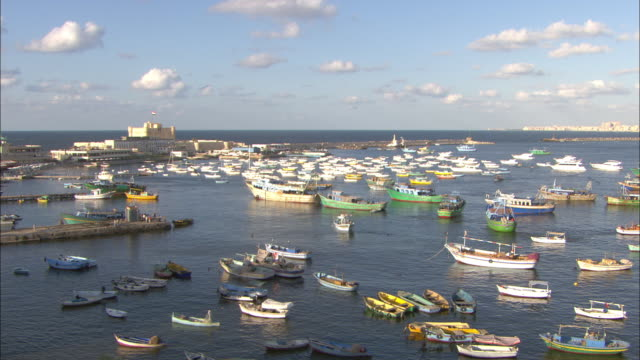 a variety of boats fill a harbor. - hafen stock-videos und b-roll-filmmaterial