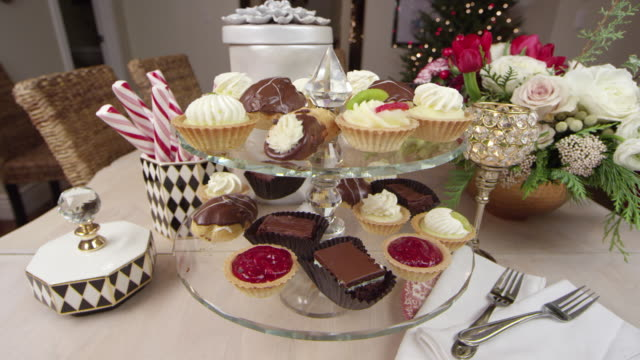 A variety of delicious desserts decoratively displayed for a Holiday/Christmas party