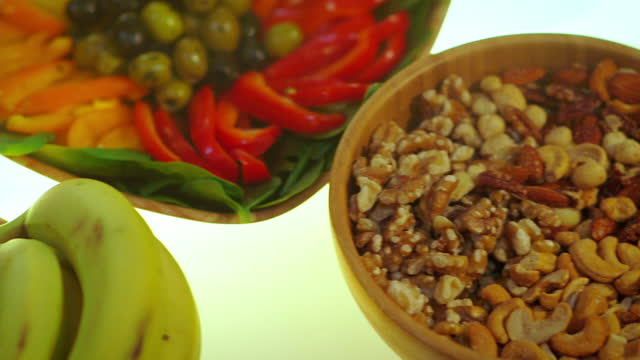 variety of food types on backlit table - tilt up stock videos & royalty-free footage