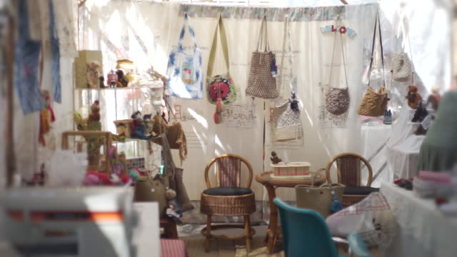 variety of handcrafted bags on display in a shop, handmade and handicraft concept. - bag stock videos & royalty-free footage