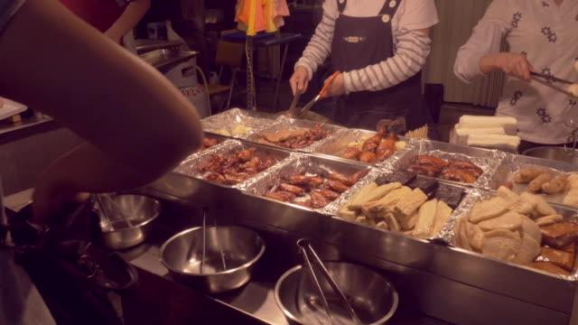 variety of meats served at a night market in taipei, taiwan - 台北市点の映像素材/bロール
