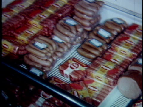 CU PAN Variety of packaged meats in grocery store / USA