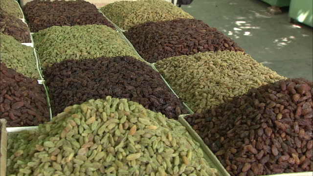 a variety of raisins are displayed at a raisin market in silk road china - raisin stock videos and b-roll footage