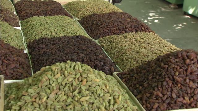 a variety of raisins are displayed at a raisin market in silk road china - raisin stock videos & royalty-free footage