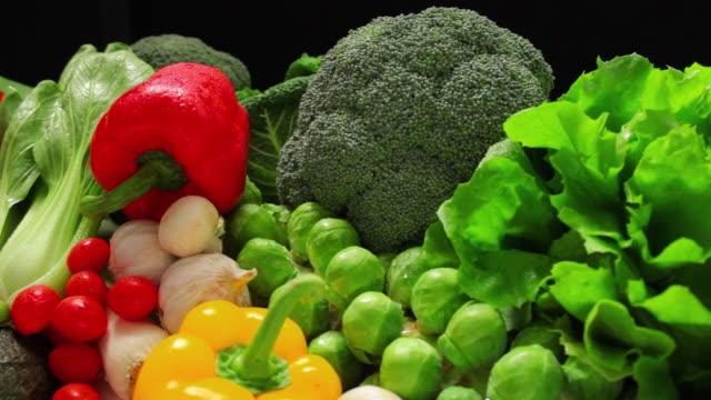 CU PAN Variety of Vegetables against black background / London, United Kingdom