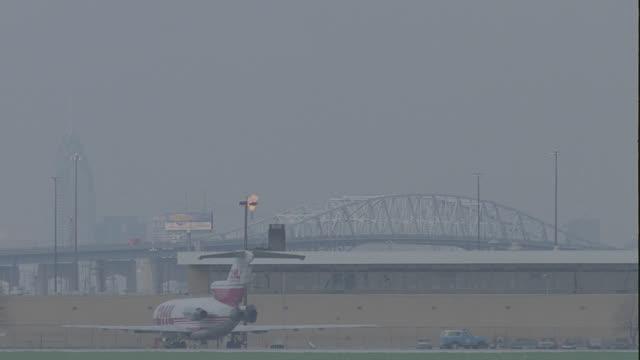 various 757 jet landings, 4 - takes: 1. american airlines; 2. northwest airlines; 3. us air; 4. oriental - luftfahrzeug stock-videos und b-roll-filmmaterial