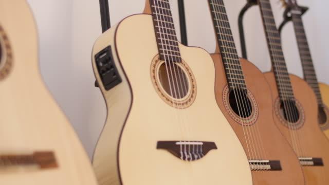 Various acoustic guitars in workshop