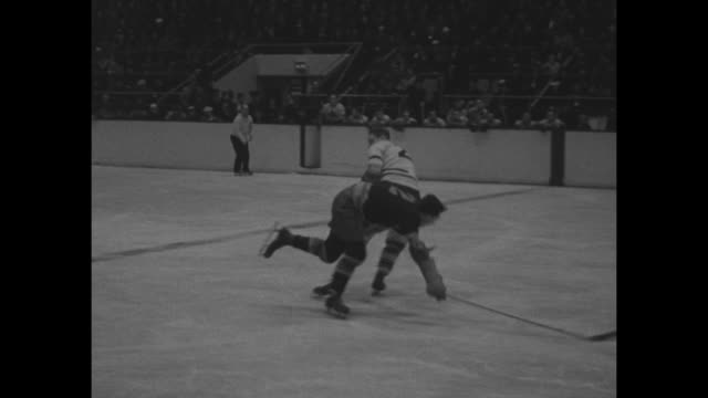 various action shots of game between new york rangers and toronto maple leafs in maple leaf gardens interspersed with shots of crowd in stands /... - 1940 stock videos & royalty-free footage