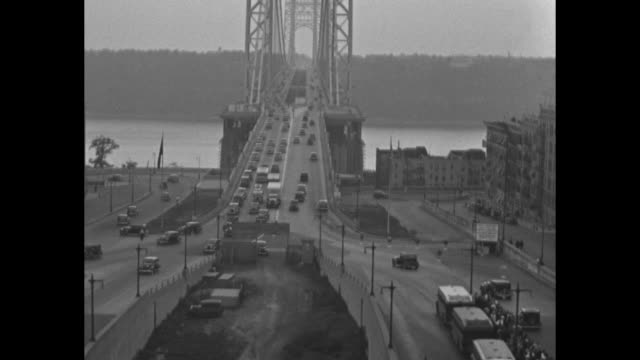 vídeos de stock e filmes b-roll de various aerial scenes traffic on the george washington bridge in new york city / toll booths on bridge / toll booth operator and cars going through... - cabina de portagem