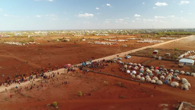 various aerial shots of newly displaced somalians, who live in makeshift tents on the outskirts of baidoa, somalia. somalia's current drought is... - somalia stock videos & royalty-free footage