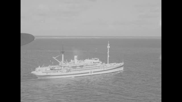 various aerial shots of ships at sea / aerial shot of bikini atoll / note exact month/date not known - bikini atoll stock videos & royalty-free footage