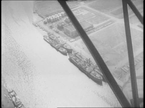 various aerial views of merchant ships in new york harbor / coast guard marching on the docks / coast guard boarding italian ship / view from deck of... - 船の一部点の映像素材/bロール