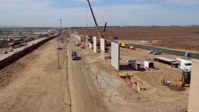 various aerial views of the border wall prototype construction site near otay mesa port of entry - prototype stock videos & royalty-free footage