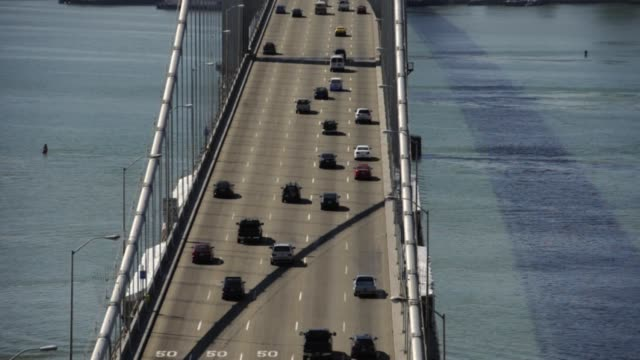 various aerial views of west bound traffic on the san francisco oakland bay bridge westbound traffic on oakland bay bridge on march 02 2012 in san... - san francisco oakland bay bridge stock videos & royalty-free footage