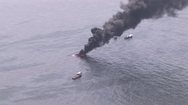 Various aerials of ships conducting controlled burns near the source of the Deepwater Horizon oil spill Gulf oil spill aerials of controlled burns on...