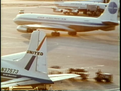stockvideo's en b-roll-footage met 1963 montage various aircraft landing and taking off at o'hare airport / chicago, united states / audio - 1963