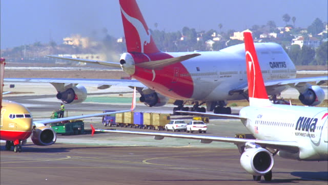 ms, pan, various aircraft moving on tarmac, los angeles, california, usa - crowded airport stock videos & royalty-free footage