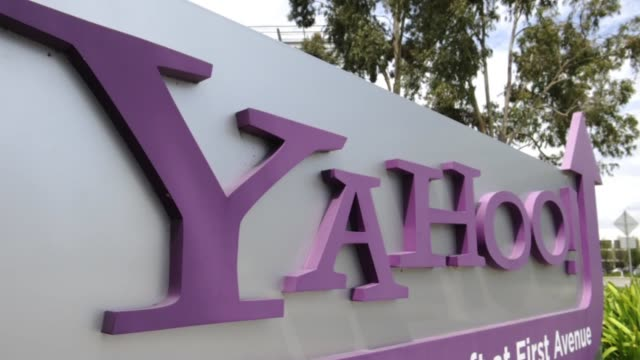 various angles and exteriors of yahoo headquarters / employees walking past entrance / spring flowers in front of signage yahoo hq exteriors on april... - yahoo brand name stock videos & royalty-free footage