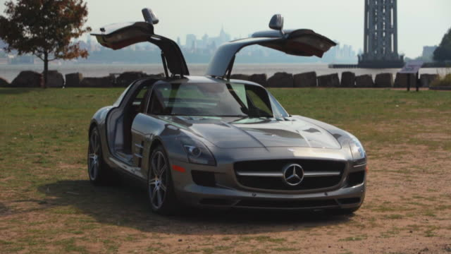 various angles and views of the 2011 mercedes-benz sls amg driving around new york city and the monticello racetrack, beauty shots of the exteriors... - 高級車点の映像素材/bロール