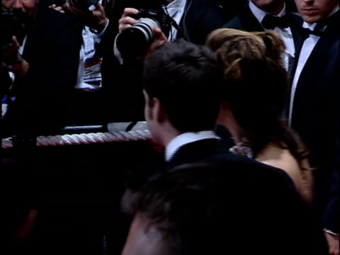various angles: family of french director, agnes varda: son mathieu demy and companion posing for paparazzi on red carpet - 撮影機材点の映像素材/bロール