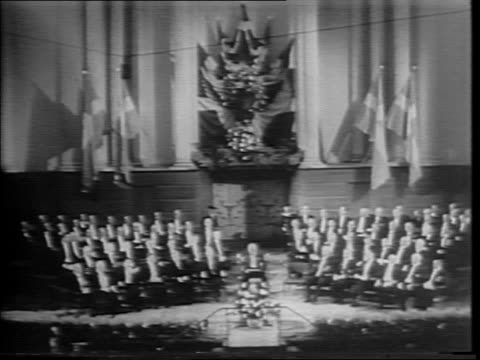 vídeos de stock, filmes e b-roll de various angles of audience at academy of science in stockholm / trumpeters with swedish flags / montage of king gustaf v of sweden and dignitaries... - 1945