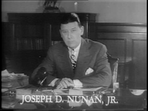Various angles of Joseph D Nunan Jr speaking at desk and holding up withholding receipt and 1040 form