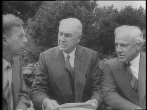 various angles of men looking at display of synthetic rubber research / montage of james b conant bernard m baruch and karl taylor compton walking... - gesellschaftliche mobilisierung stock-videos und b-roll-filmmaterial