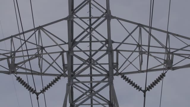 Various angles of power lines hanging from power transmission towers in Mount Prospect Illinois US Winter shots of Power Lines over a suburban...