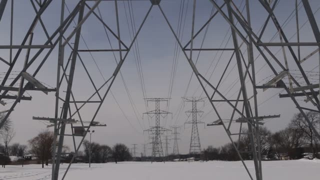 Various angles of power lines hanging from power transmission towers in Mount Prospect Illinois US on a cloudy day Winter shots of Power Lines over a...