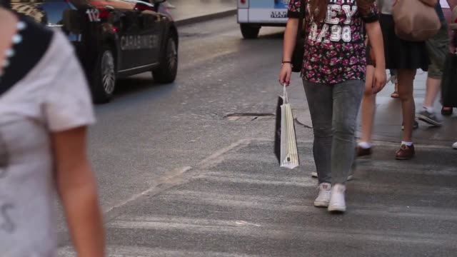 vídeos de stock, filmes e b-roll de various anonymous shots of pedestrians walking along shopping streets some carrying branded shopping bags in central rome italy on monday oct 20 back... - produto interno bruto