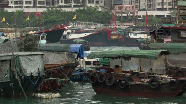 ms, various boats moored and moving at victoria harbor, hong kong, china - moored stock videos & royalty-free footage