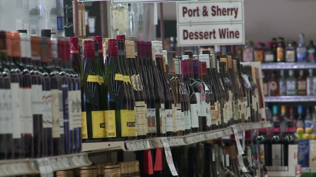 wgn various bottles of alcohol on shelves at a liquor store in chicago on april 21 2016 - liquor store stock videos and b-roll footage