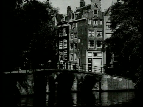 1940 b/w various bridges, canals, houses and gables / amsterdam, noord-holland, netherlands - 1940 stock-videos und b-roll-filmmaterial