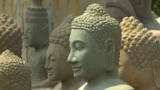 various buddha stone statues in san tok, cambodia - effigy stock videos & royalty-free footage