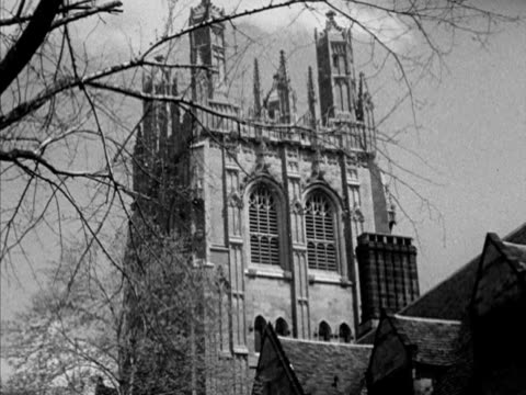Various campus buildings at Yale University including the Harkness Tower various students walking on campus entrance to Yale Daily News building on...