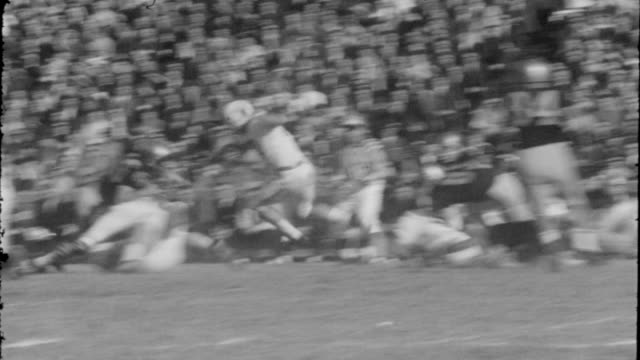 Various clips from the sidelines of the football field Black and white 16mm film of college football footage from the 1960's Collegiate Football...