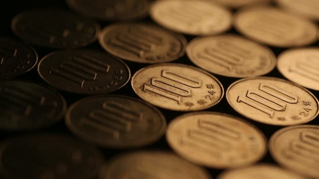 various close shots japanese 100 yen coins are laid out in arranged shots in tokyo japan on wednesday feb 5 2014 japanese yen currency on february 05... - 硬貨点の映像素材/bロール