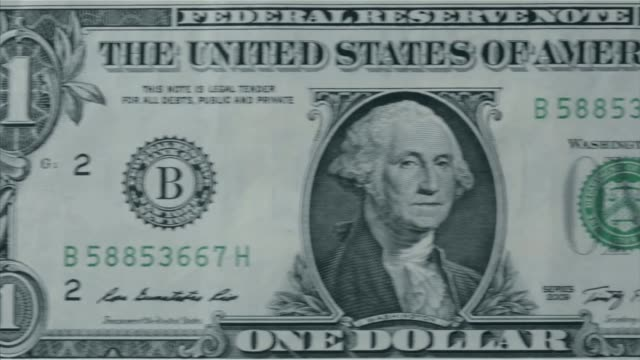 various close up shots and panning shots of a american one dollar bill close up shots focus on the portrait of george washington on the one dollar... - george washington portrait stock videos and b-roll footage